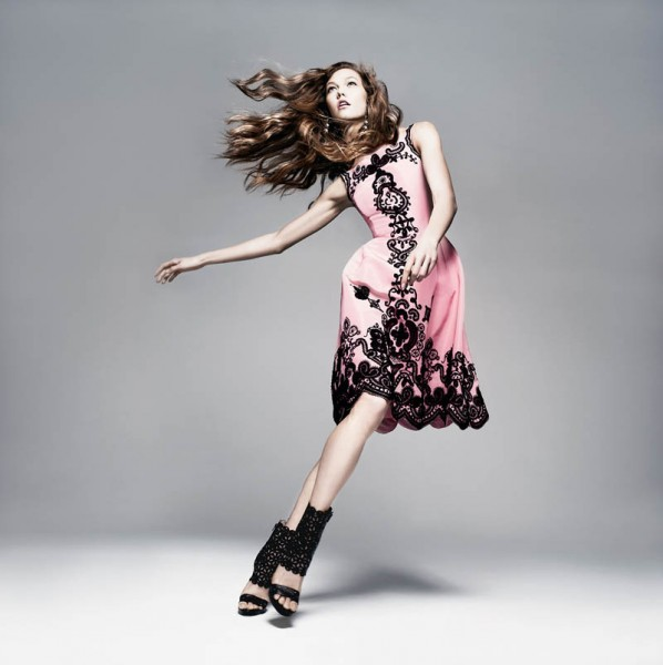 Jumping, Jumping: Taking a leap on the page provides some action to a basic studio shot. Karlie Kloss certainly knows how to show off an outfit. Karlie Kloss for Neiman Marcus Art of Fashion 2013