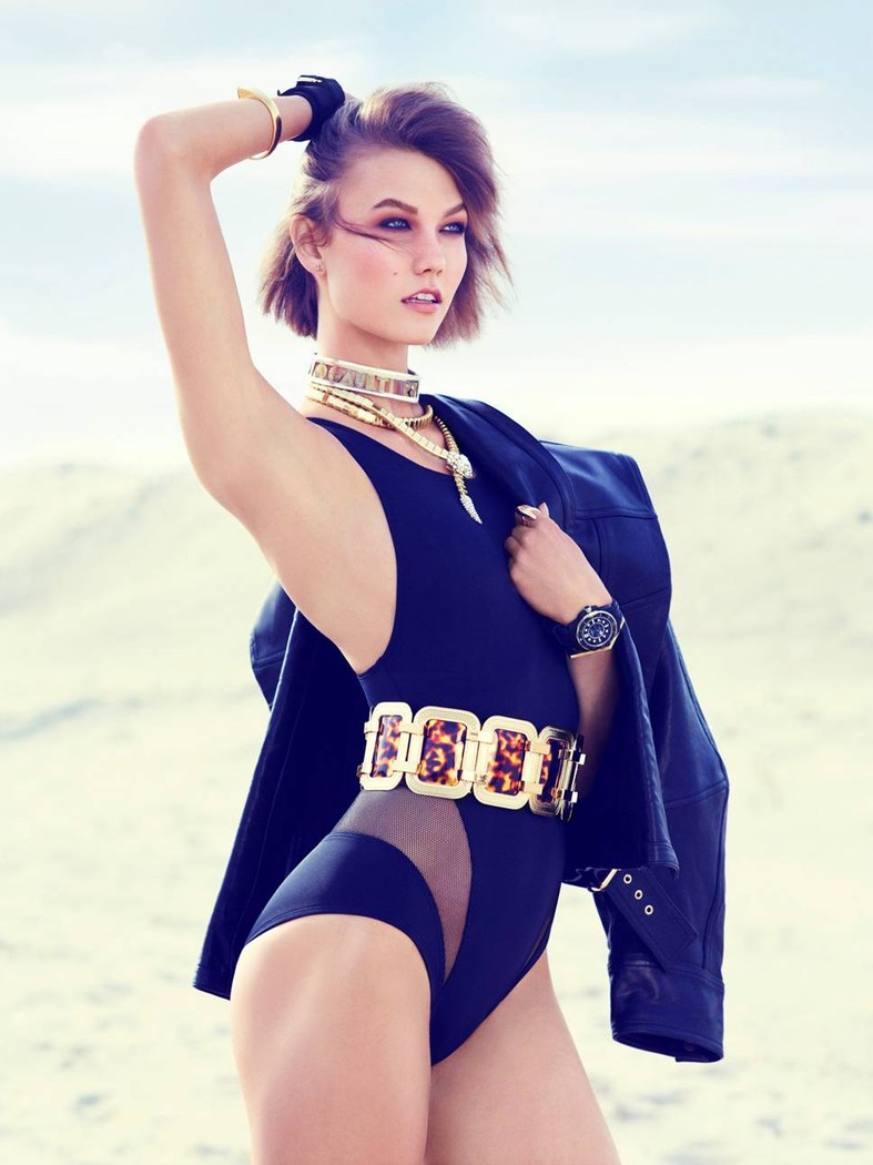 Swimsuit Clad Karlie Kloss Poses for Miguel Reveriego in Vogue Turkey June 2013