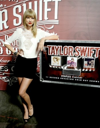 "Taylor Swift Wears Elie Saab at her ""Red Tour"" Press Conference"