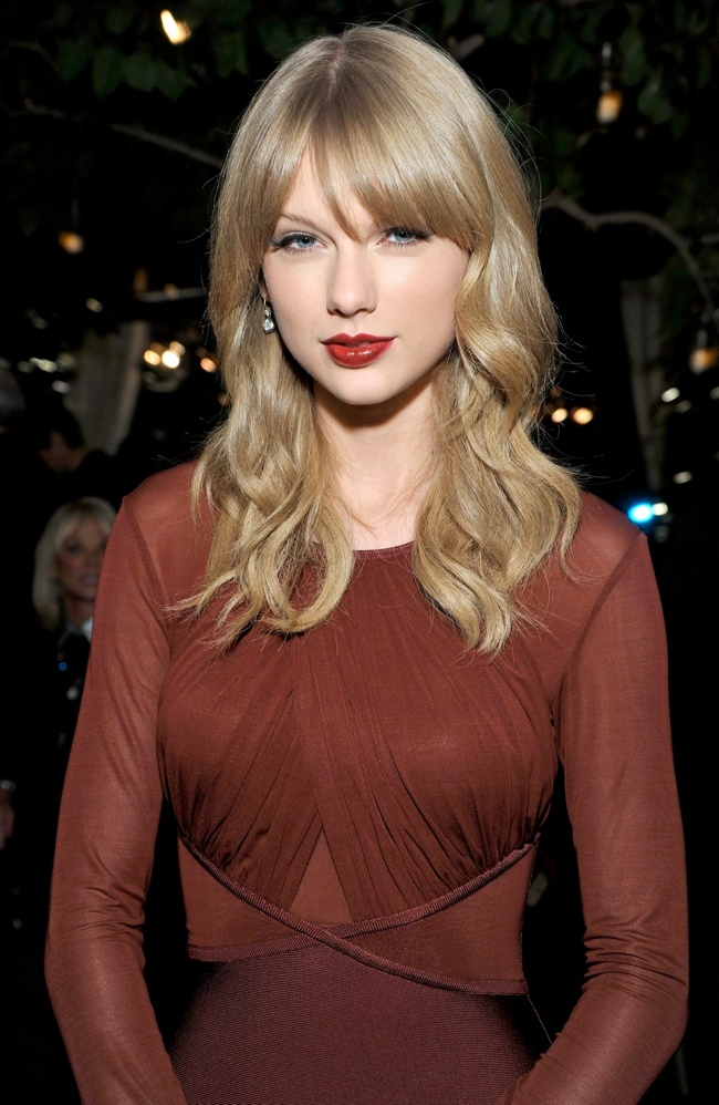 taylor red dress2 Taylor Swift Wows in Hervé L. Leroux Dress at Weinstein Companys Holiday Party