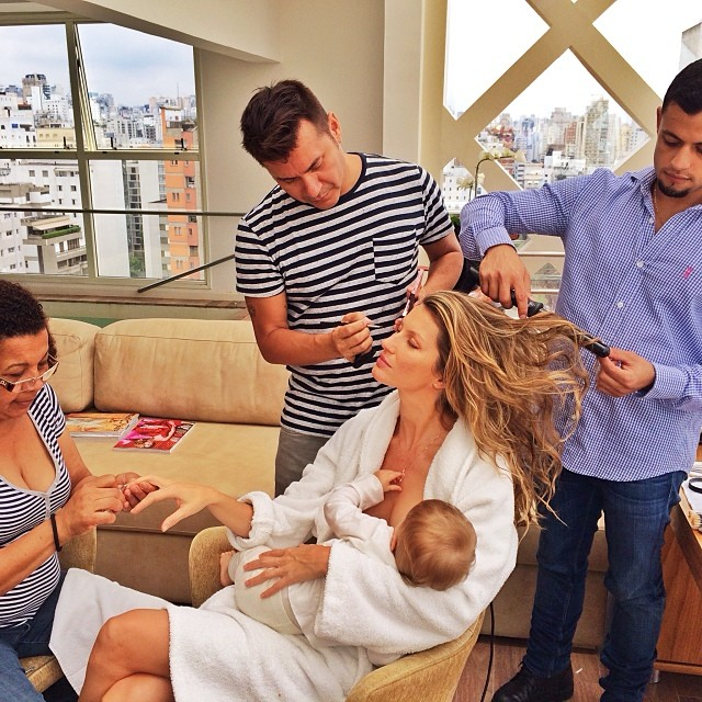 Gisele with her glam squad and breastfeeding her daughter Vivian Lake / Image courtesy of Instagram