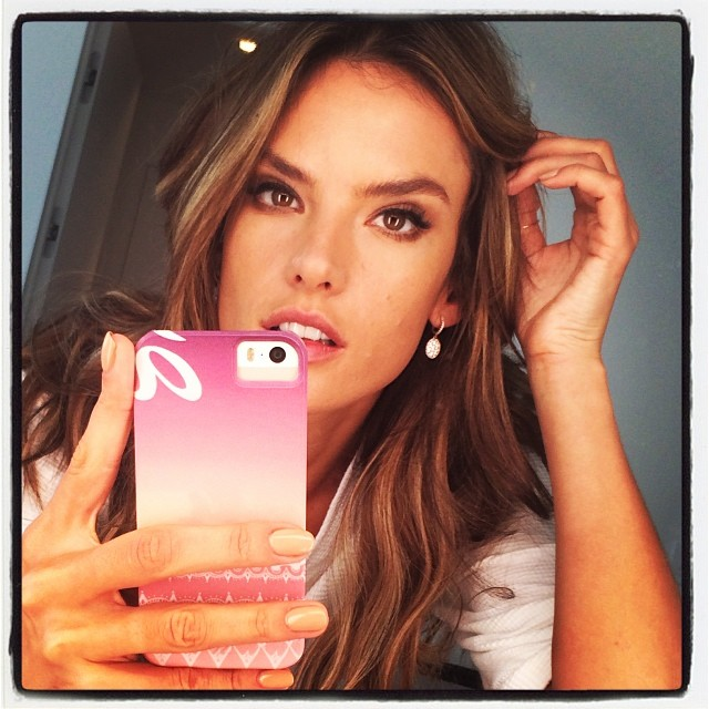 WORK THE MIRROR: Brazilian model Alessandra Ambrosio takes a selfie while flashing her phone cover in the mirror. Take it back to days of MySpace.