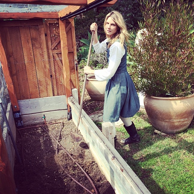Angela Lindvall poses in her garden wearing Chanel