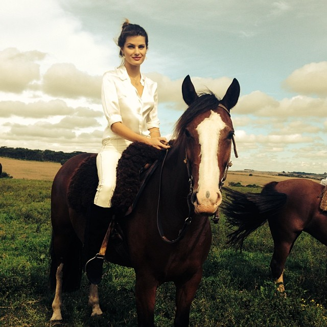 Isabeli Fontana poses on the back of a horse