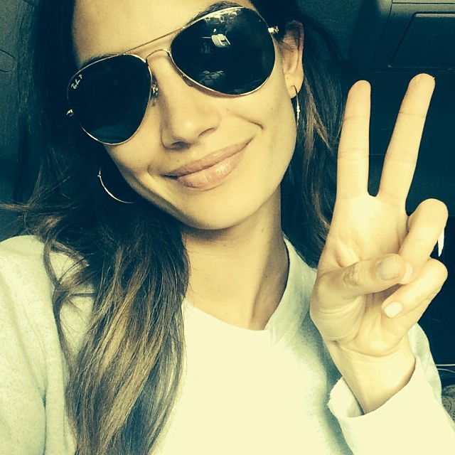Lily Aldridge flashes the peace sign