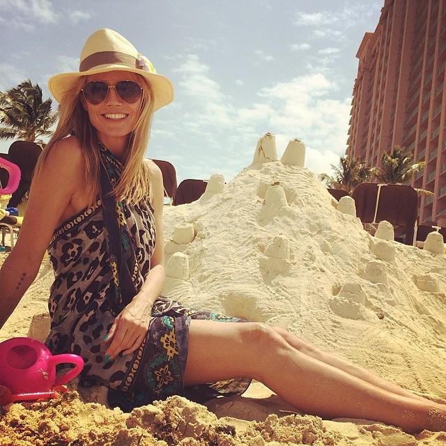 Heidi Klum with sand castles on the beach