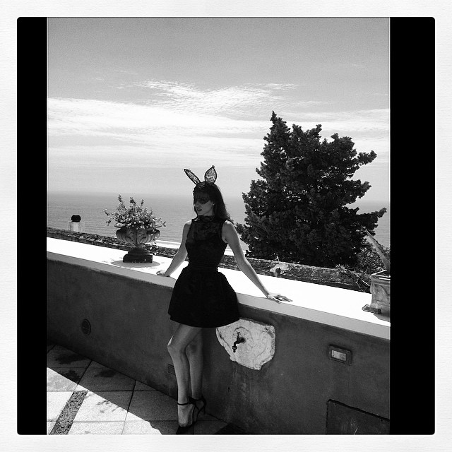 BLACK & WHITE: Irina poses in dress and bunny ears. Image: Instagram alikavoussi