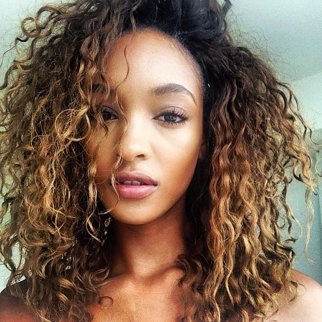 Jourdan Dunn with a curly blondish hairdo