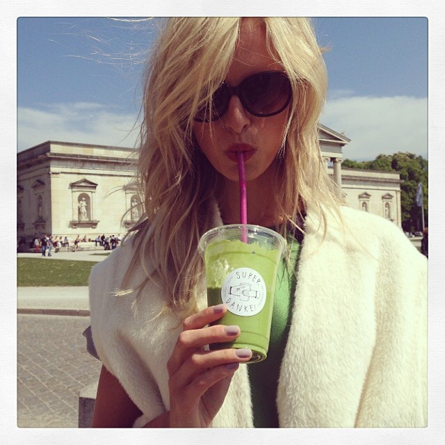 Karolina Kurkova sips on a green drink