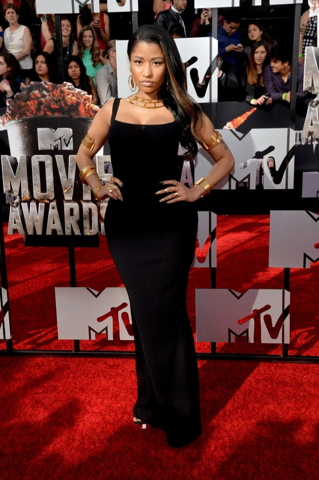 Rapper Nicki Minaj tones it down in Alexander McQueen dress