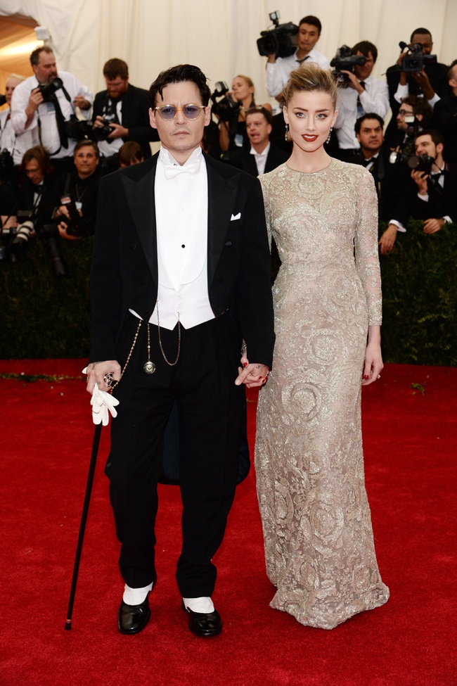 Amber Heard poses alongside fiance Johnny Depp in Giambattista Valli gown
