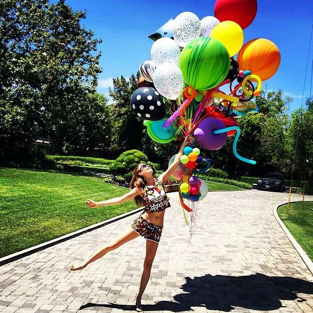 Behati Prinsloo has some fun with balloons