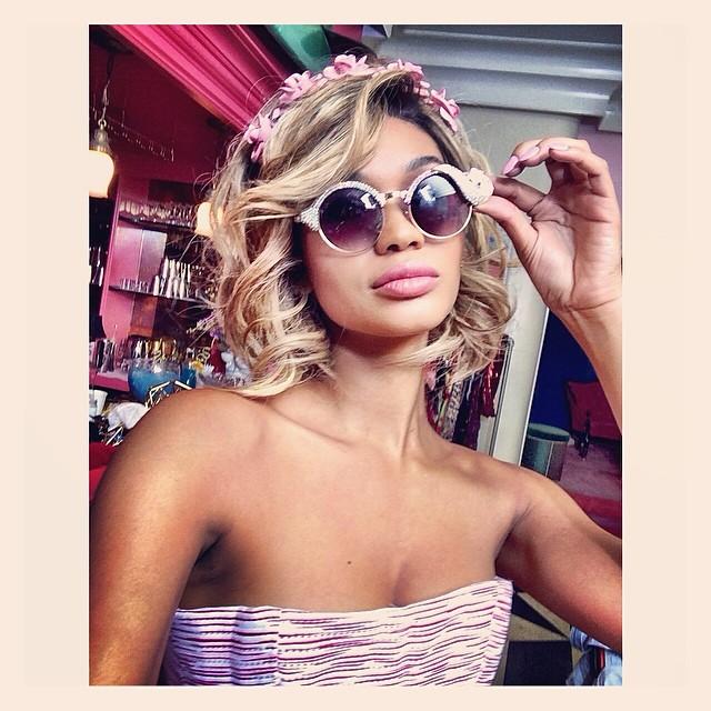 Chanel Iman wears a blonde wig