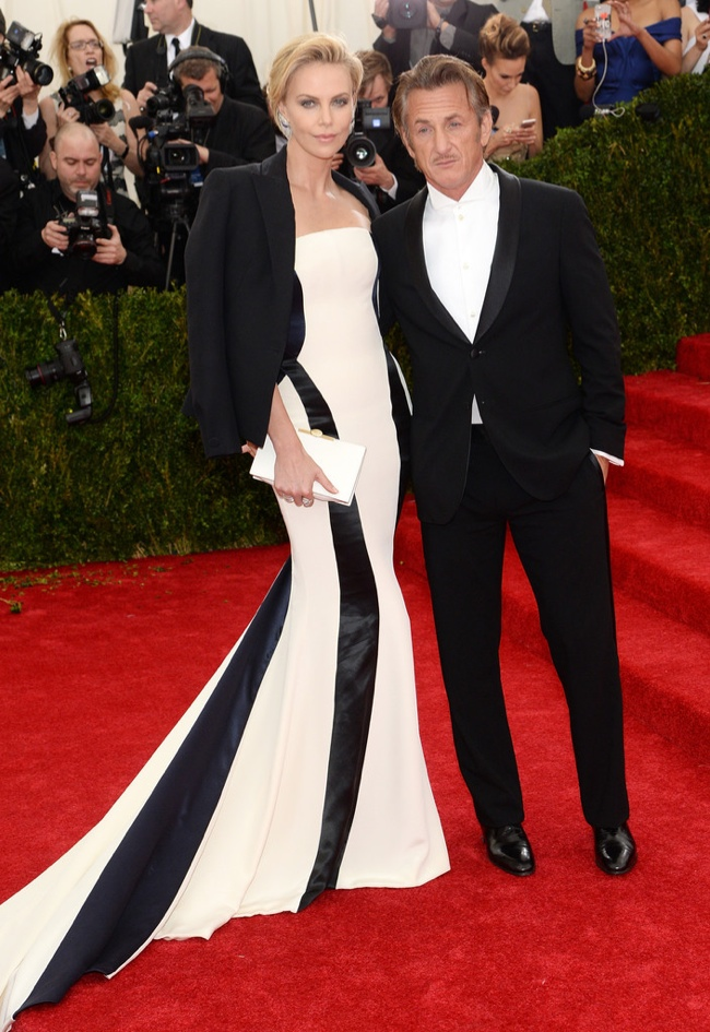 Charlize Theron wears black and white Dior alongside Sean Penn