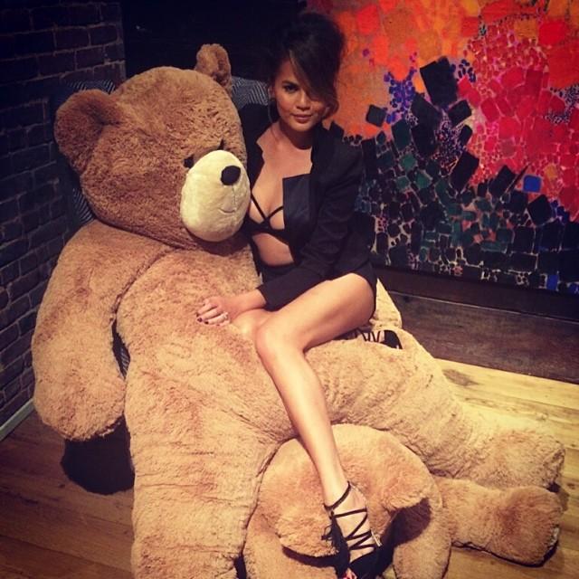 Chrissy Teigen poses with a big teddy bear