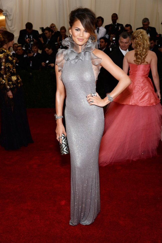 Chrissy Teigen shines in silver Ralph Lauren gown