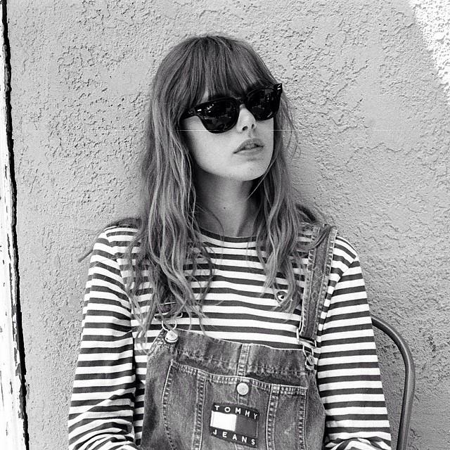 Frida Gustavsson in denim overalls look