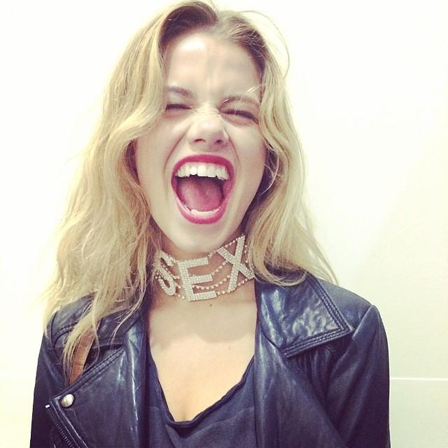 Hailey Clauson wears SEX necklace
