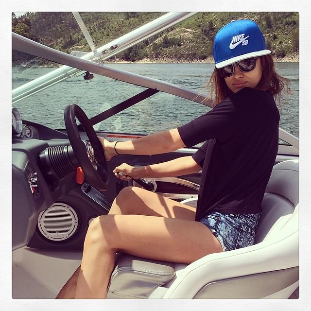 Irina Shayk steers a boat