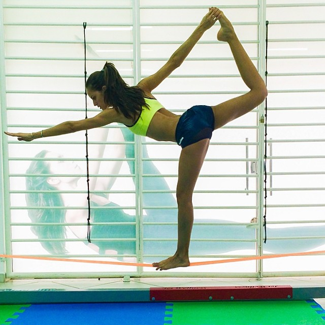 Izabel Goulart shows off a yoga pose