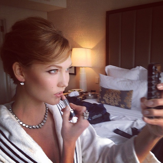 Karlie Kloss getting glam for the main event