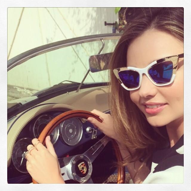 Miranda Kerr drives a car in sunglasses