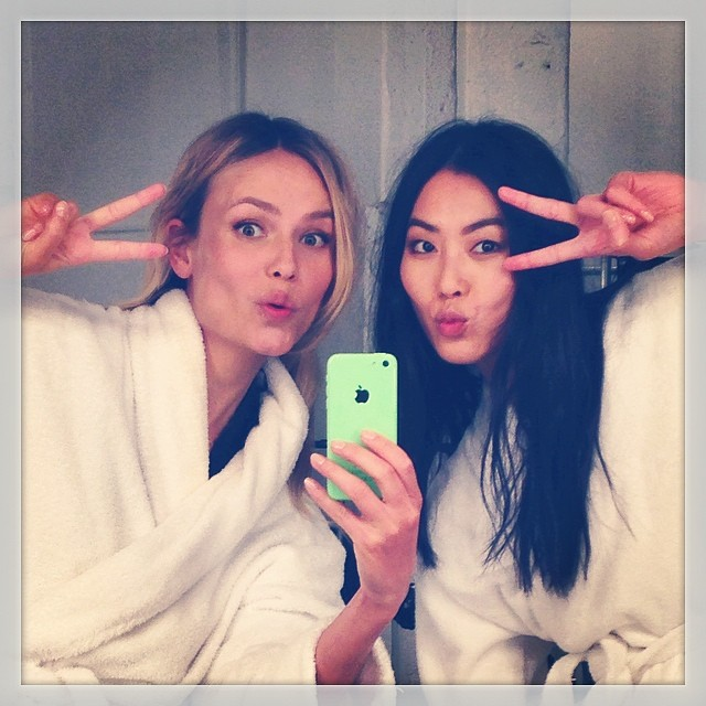 Natasha Poly and Liu Wen take a selfie while on set