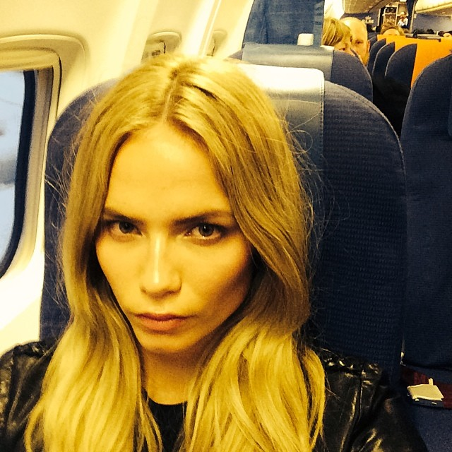 Natasha Poly on a plane