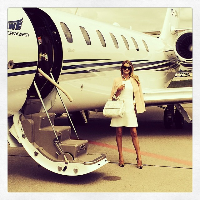 Rosie Huntington-Whiteley certainly knows how to fly in style. Here she is wearing a little white dress and bag before boarding a private jet. Photo via Instagram.