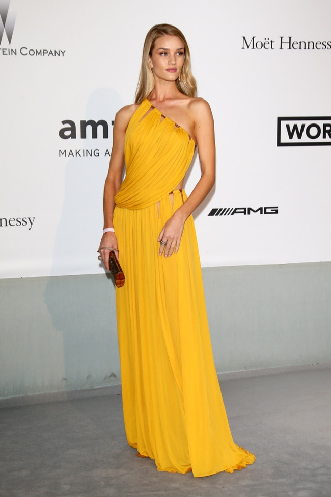 Rosie Huntington-Whiteley modeled a mustard colored Emilio Pucci gown