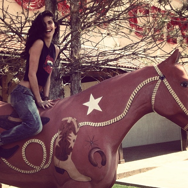 Sara Sampaio poses on a horse