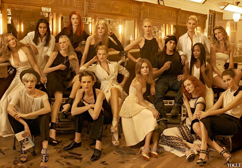 Steven Meisel (far right) surrounded by top models. Image: Vogue May 2009 Issue