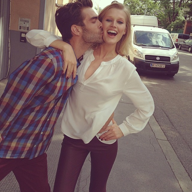 Toni Garrn & Jon K pal around on set