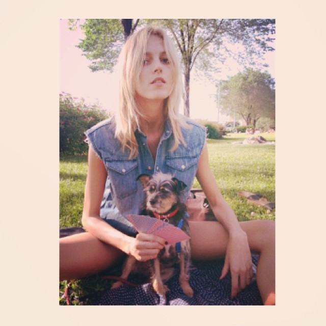 Anja Rubik poses with a dog