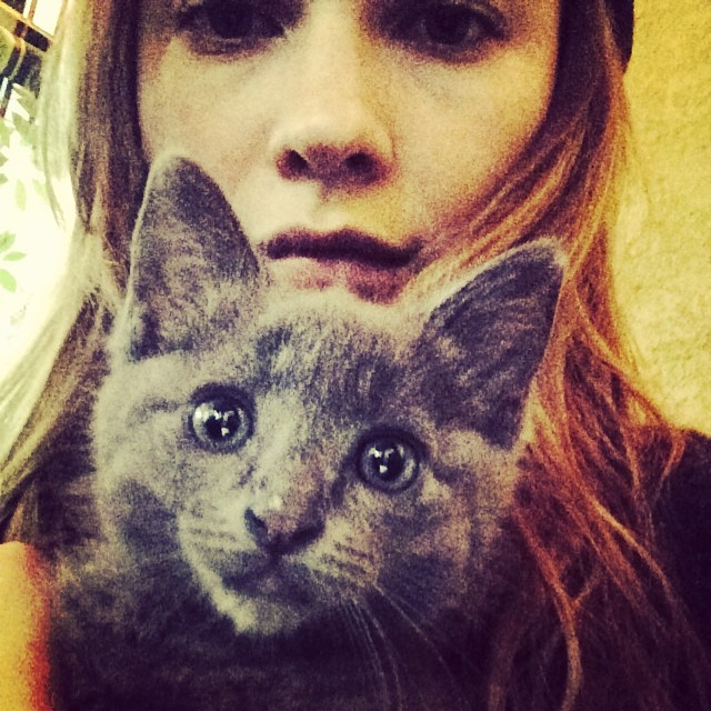 Behati Prinsloo takes a selfie with her cat