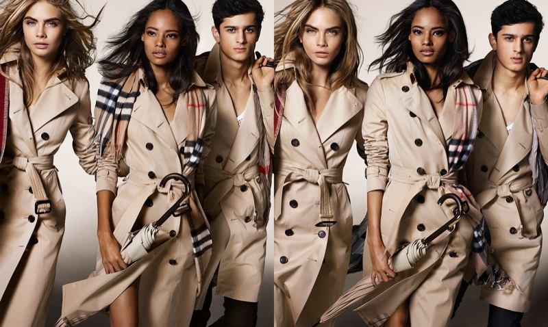 Models wears Burberry trench coats in fall-winter 2014 campaign. The sleek and slim silhouette differs from its roots.
