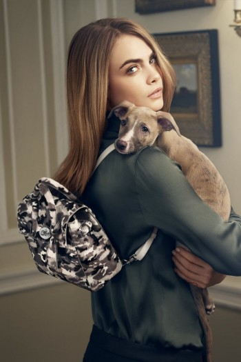 Cara Delevingne poses with pooch in Mulberry shoot