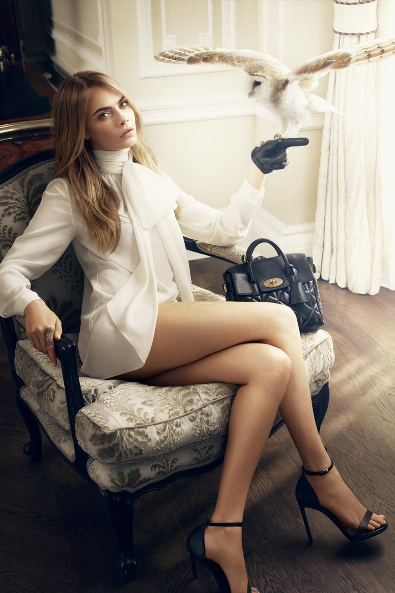 Cara Delevingne poses with owl for Mulberry shoot