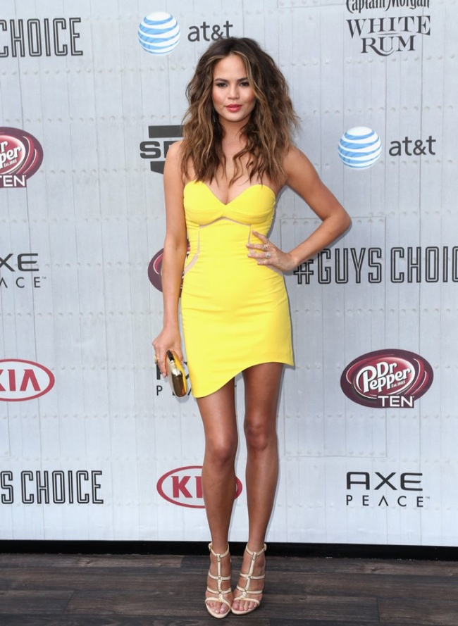 Chrissy Teigen was a bright spot in a yellow Three Floor dress