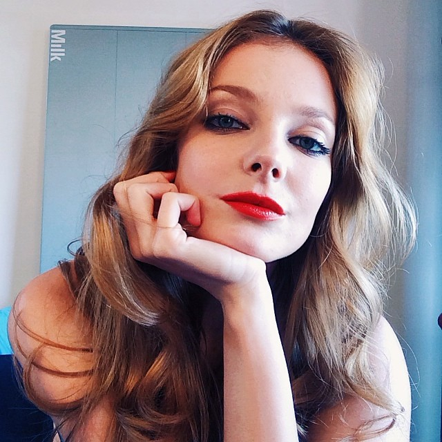Eniko Mihalik shows off red lipstick