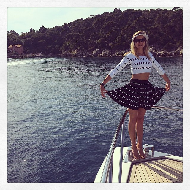 Jessica Hart poses on a boat