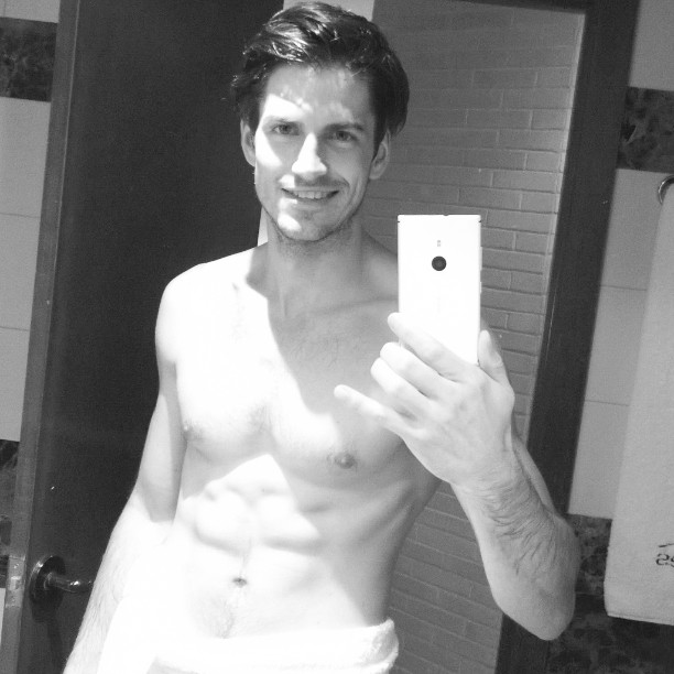 Jakub Zelman takes a black and white shirtless selfie