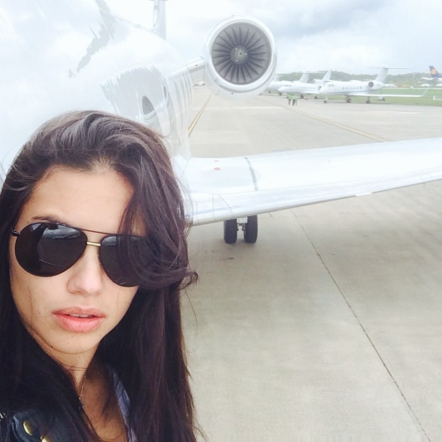WORK THE BACKGROUND: A private jet is a nice start like with Adriana Lima's selfie, but this supermodel proves you can work the background anywhere--at the beach, a concert or even at home. Use the background to your advantage.