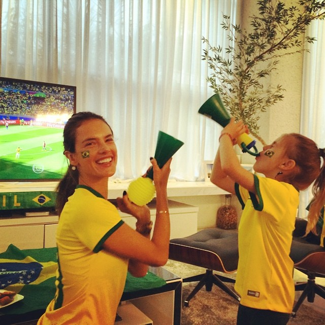 Alessandra Ambrosio and her daughter celebrate the World Cup