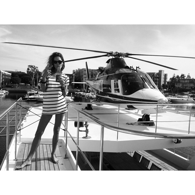 Erin Wasson poses on a boat