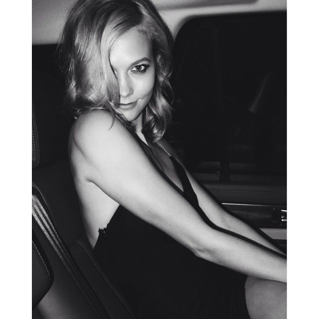Karlie Kloss in car during couture fashion week by Mario Testino