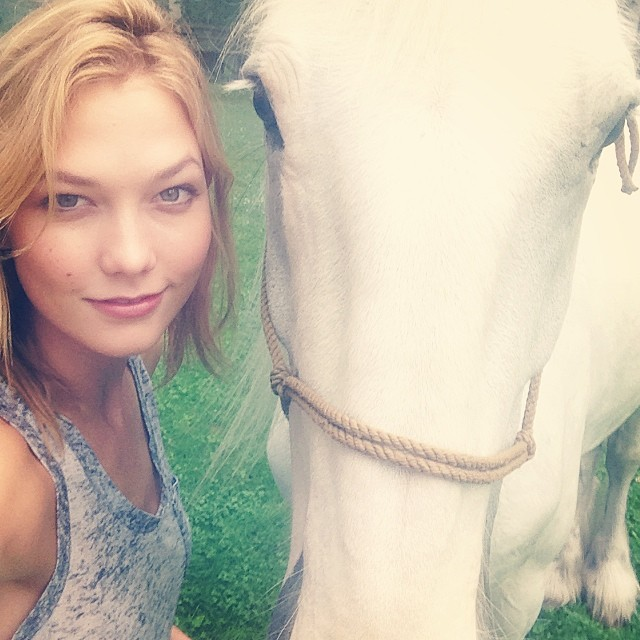 Karlie Kloss poses with a horse