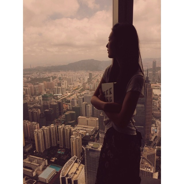 Liu Wen looks out at the city