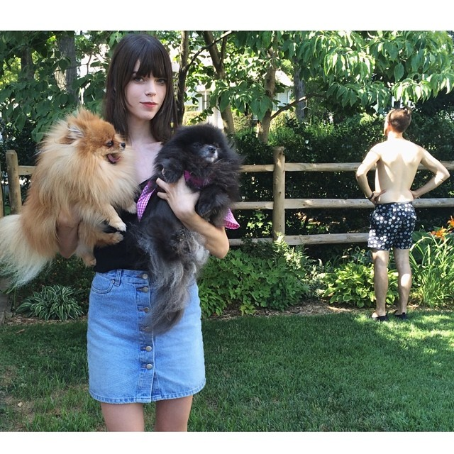 Megan Collison poses with pooches