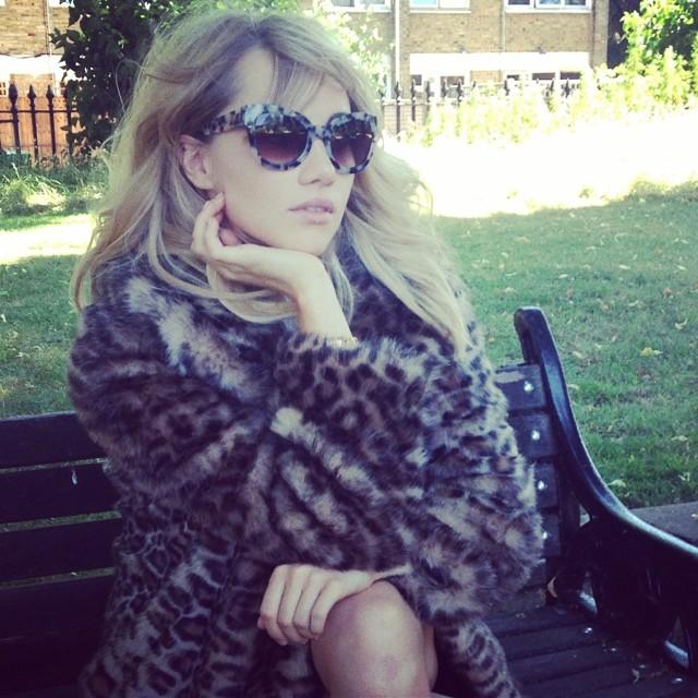 Suki Waterhouse in fur coat and sunglasses